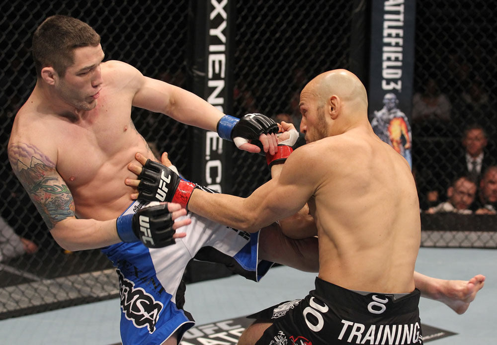 TORONTO, ON - DECEMBER 10:  (L-R) Jake Hecht kicks Rich Attonito during the UFC 140 event at Air Canada Centre on December 10, 2011 in Toronto, Ontario, Canada.  (Photo by Nick Laham/Zuffa LLC/Zuffa LLC via Getty Images)