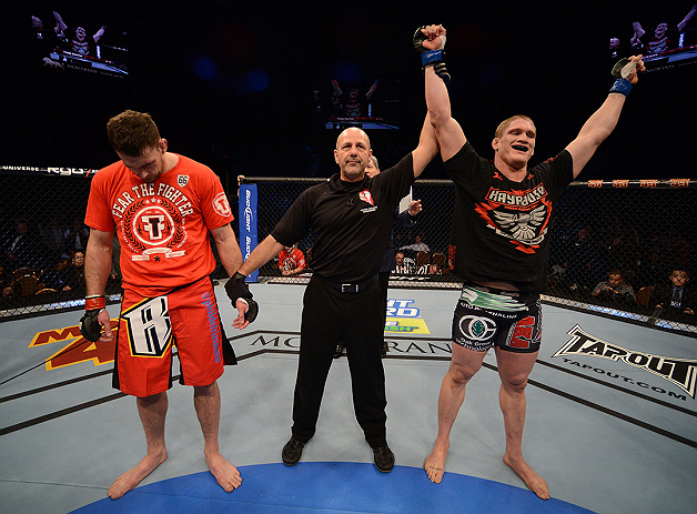 LAS VEGAS, NV - DECEMBER 29:  Todd Duffee (right) is declared the winner over Phil De Fries (left) after their heavyweight fight at UFC 155 on December 29, 2012 at MGM Grand Garden Arena in Las Vegas, Nevada. (Photo by Donald Miralle/Zuffa LLC/Zuffa LLC via Getty Images) *** Local Caption *** Phil De Fries; Todd Duffee