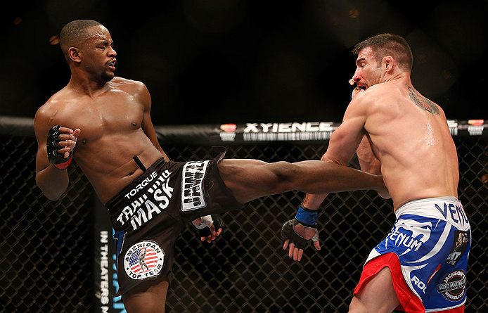 LAS VEGAS, NV - FEBRUARY 02:  (L-R) Yves Edwards kicks Isaac Vallie-Flagg during their lightweight fight at UFC 156 on February 2, 2013 at the Mandalay Bay Events Center in Las Vegas, Nevada.  (Photo by Josh Hedges/Zuffa LLC/Zuffa LLC via Getty Images) *** Local Caption *** Yves Edwards; Isaac Vallie-Flagg