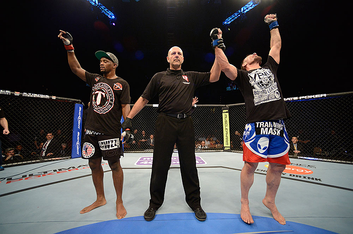 LAS VEGAS, NV - FEBRUARY 02:  Isaac Vallie-Flagg (right) reacts to his victory over Yves Edwards (left) during their lightweight fight at UFC 156 on February 2, 2013 at the Mandalay Bay Events Center in Las Vegas, Nevada.  (Photo by Donald Miralle/Zuffa LLC/Zuffa LLC via Getty Images) *** Local Caption *** Yves Edwards; Isaac Vallie-Flagg