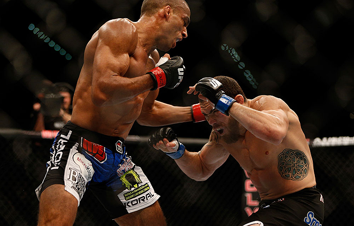 (L-R) Edson Barboza punches Rafaello Oliveira in their lightweight fight during the UFC 162 event inside the MGM Grand Garden Arena on July 6, 2013 in Las Vegas, NV. (Photo by Josh Hedges/Zuffa LLC)