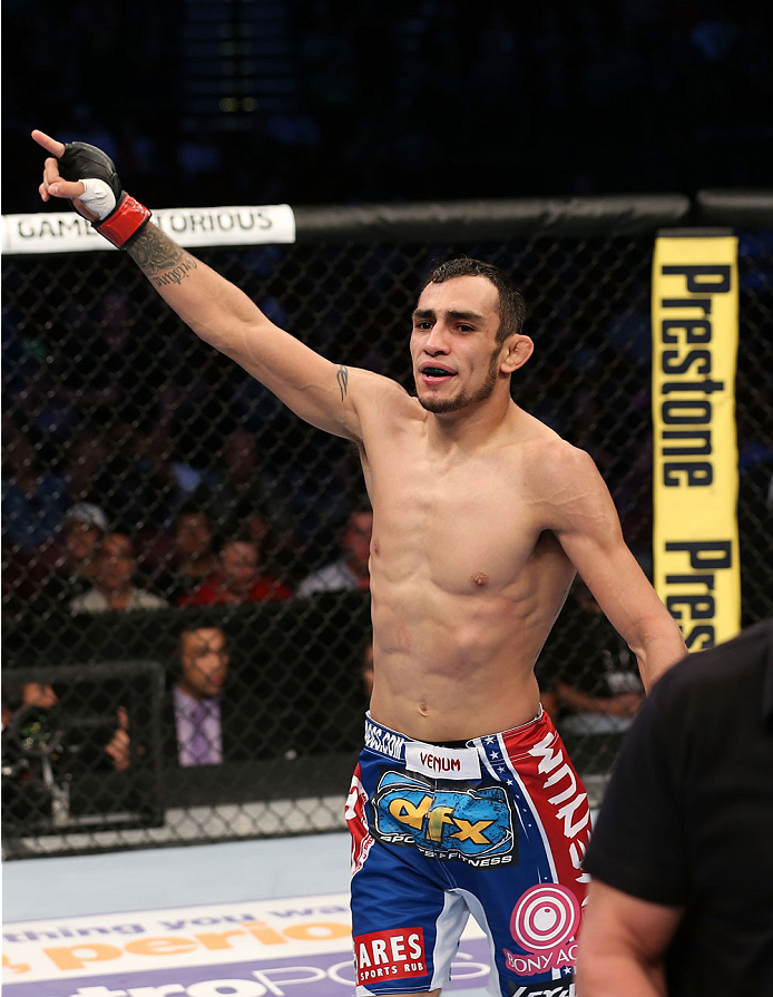 HOUSTON, TEXAS - OCTOBER 19:  Tony Ferguson celebrates after submitting Mike Rio (not pictured) by d'arce choke in their UFC lightweight bout at the Toyota Center on October 19, 2013 in Houston, Texas. (Photo by Nick Laham/Zuffa LLC/Zuffa LLC via Getty Images)