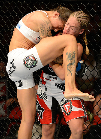 SEATTLE, WA - JULY 27: (L-R) Germaine de Randamie knees Julie Kedzie in their bantamweight bout during the UFC on FOX event at Key Arena on July 27, 2013 in Seattle, Washington. (Photo by Jeff Bottari/Zuffa LLC/Zuffa LLC via Getty Images) *** Local Caption *** Julie Kedzie; Germaine de Randamie