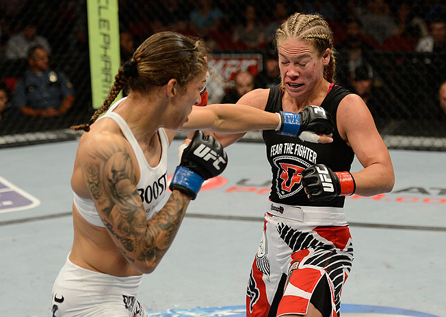 SEATTLE, WA - JULY 27: (L-R) Germaine de Randamie punches Julie Kedzie in their bantamweight bout during the UFC on FOX event at Key Arena on July 27, 2013 in Seattle, Washington. (Photo by Jeff Bottari/Zuffa LLC/Zuffa LLC via Getty Images) *** Local Caption *** Julie Kedzie; Germaine de Randamie