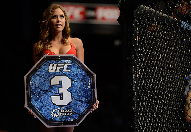 SEATTLE, WA - JULY 27: UFC Octagon Girl Brittney Palmer introduces round three of Kedzie vs de Randamie in their bantamweight bout during the UFC on FOX event at Key Arena on July 27, 2013 in Seattle, Washington. (Photo by Jeff Bottari/Zuffa LLC/Zuffa LLC via Getty Images) *** Local Caption *** Brittney Palmer