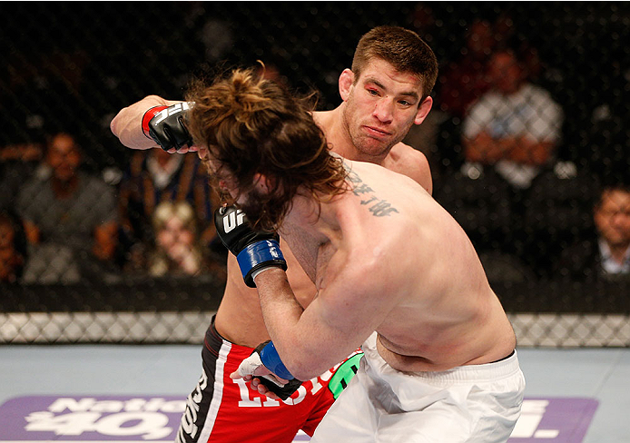 SACRAMENTO, CA - DECEMBER 14:  Sam Stout (top) punches Cody McKenzie in their lightweight bout during the UFC on FOX event at Sleep Train Arena on December 14, 2013 in Sacramento, California. (Photo by Josh Hedges/Zuffa LLC/Zuffa LLC via Getty Images) *** Local Caption *** Sam Stout; Cody McKenzie