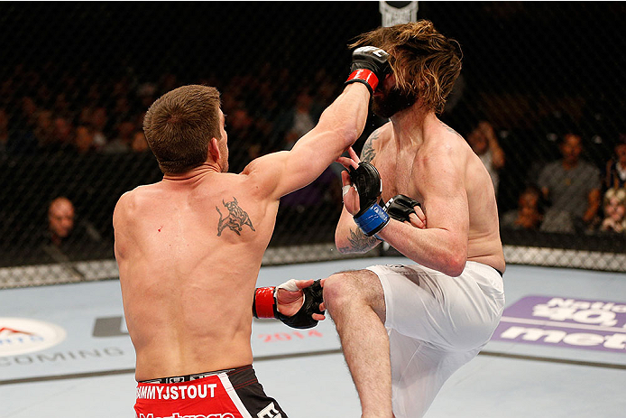 SACRAMENTO, CA - DECEMBER 14:  (L-R) Sam Stout punches Cody McKenzie in their lightweight bout during the UFC on FOX event at Sleep Train Arena on December 14, 2013 in Sacramento, California. (Photo by Josh Hedges/Zuffa LLC/Zuffa LLC via Getty Images) *** Local Caption *** Sam Stout; Cody McKenzie