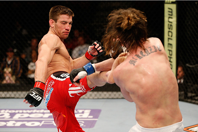 SACRAMENTO, CA - DECEMBER 14:  (L-R) Sam Stout kicks Cody McKenzie in their lightweight bout during the UFC on FOX event at Sleep Train Arena on December 14, 2013 in Sacramento, California. (Photo by Josh Hedges/Zuffa LLC/Zuffa LLC via Getty Images) *** Local Caption *** Sam Stout; Cody McKenzie