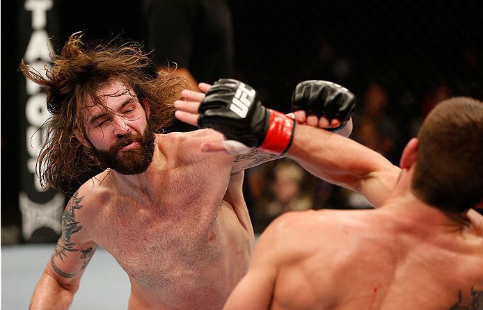 SACRAMENTO, CA - DECEMBER 14:  Cody McKenzie (left) punches Sam Stout (right) in their lightweight bout during the UFC on FOX event at Sleep Train Arena on December 14, 2013 in Sacramento, California. (Photo by Josh Hedges/Zuffa LLC/Zuffa LLC via Getty Images) *** Local Caption *** Sam Stout; Cody McKenzie