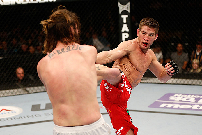 SACRAMENTO, CA - DECEMBER 14:  Sam Stout (right) kicks Cody McKenzie in their lightweight bout during the UFC on FOX event at Sleep Train Arena on December 14, 2013 in Sacramento, California. (Photo by Josh Hedges/Zuffa LLC/Zuffa LLC via Getty Images) *** Local Caption *** Sam Stout; Cody McKenzie
