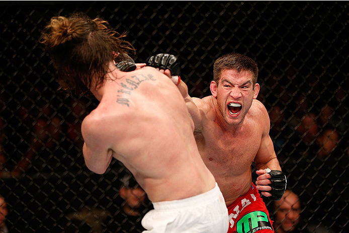 SACRAMENTO, CA - DECEMBER 14:  (R-L) Sam Stout punches Cody McKenzie in their lightweight bout during the UFC on FOX event at Sleep Train Arena on December 14, 2013 in Sacramento, California. (Photo by Josh Hedges/Zuffa LLC/Zuffa LLC via Getty Images) *** Local Caption *** Sam Stout; Cody McKenzie