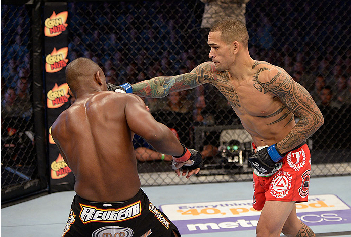 FORT CAMPBELL, KENTUCKY - NOVEMBER 6:  (R-L) Yancy Medeiros punches Yves Edwards in their UFC lightweight bout on November 6, 2013 in Fort Campbell, Kentucky. (Photo by Jeff Bottari/Zuffa LLC/Zuffa LLC via Getty Images) *** Local Caption ***Yves Edwards; Yancy Medeiros