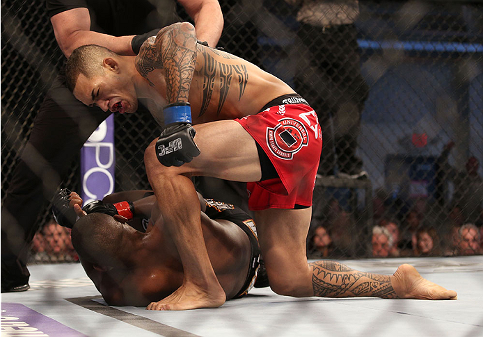 FORT CAMPBELL, KENTUCKY - NOVEMBER 6:  Yancy Medeiros (top) punches Yves Edwards in their UFC lightweight bout on November 6, 2013 in Fort Campbell, Kentucky. (Photo by Ed Mulholland/Zuffa LLC/Zuffa LLC via Getty Images) *** Local Caption ***Yves Edwards; Yancy Medeiros