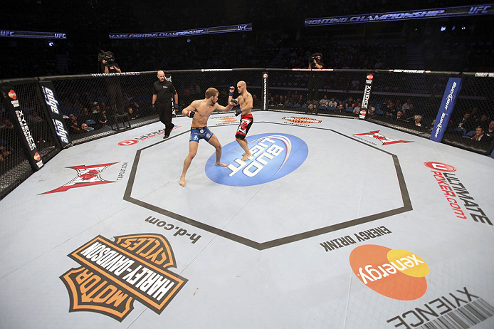 CALGARY, CANADA - JULY 21: (L-R) Bryan Caraway throws a punch at Mitch Gagnon during their bantamweight bout at UFC 149 inside the Scotiabank Saddledome on July 21, 2012 in Calgary, Alberta, Canada.  (Photo by Nick Laham/Zuffa LLC/Zuffa LLC via Getty Images)