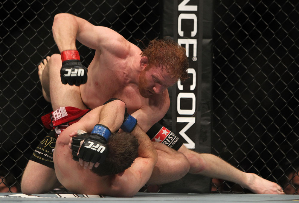 TORONTO, ON - DECEMBER 10:  Mark Bocek punches down at Nik Lentz on the ground during the UFC 140 event at Air Canada Centre on December 10, 2011 in Toronto, Ontario, Canada.  (Photo by Josh Hedges/Zuffa LLC/Zuffa LLC via Getty Images)