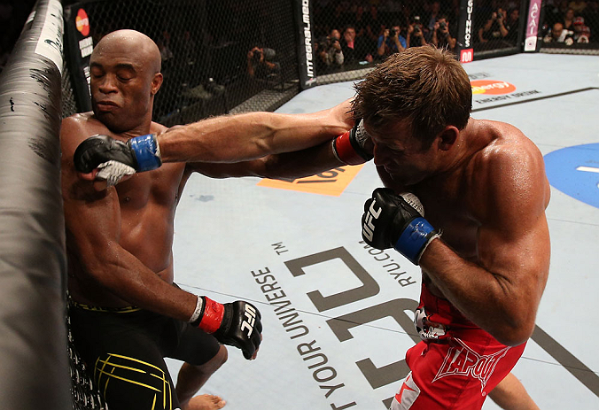 RIO DE JANEIRO, BRAZIL - OCTOBER 13:  (R-L) Stephan Bonnar punches Anderson Silva during their light heavyweight fight at UFC 153 inside HSBC Arena on October 13, 2012 in Rio de Janeiro, Brazil.  (Photo by Josh Hedges/Zuffa LLC/Zuffa LLC via Getty Images)