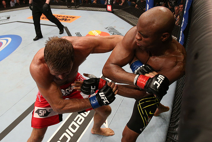 RIO DE JANEIRO, BRAZIL - OCTOBER 13:  (R-L) Anderson Silva punches Stephan Bonnar during their light heavyweight fight at UFC 153 inside HSBC Arena on October 13, 2012 in Rio de Janeiro, Brazil.  (Photo by Josh Hedges/Zuffa LLC/Zuffa LLC via Getty Images)