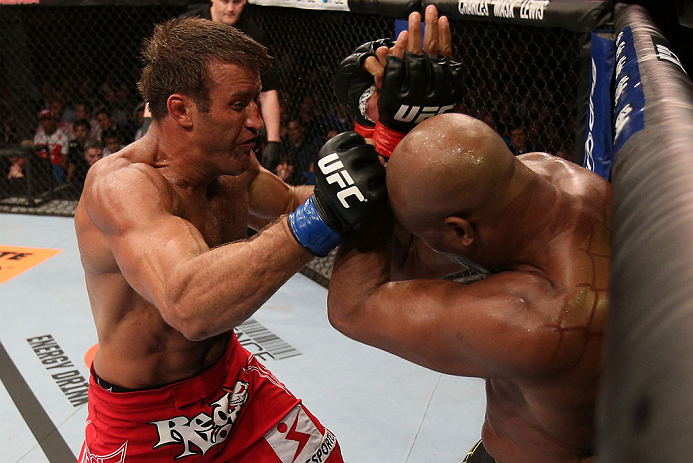 RIO DE JANEIRO, BRAZIL - OCTOBER 13:  (L-R) Stephan Bonnar punches Anderson Silva during their light heavyweight fight at UFC 153 inside HSBC Arena on October 13, 2012 in Rio de Janeiro, Brazil.  (Photo by Josh Hedges/Zuffa LLC/Zuffa LLC via Getty Images)