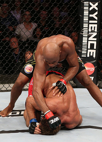 RIO DE JANEIRO, BRAZIL - OCTOBER 13:   Anderson Silva (top) punches Stephan Bonnar during their light heavyweight fight at UFC 153 inside HSBC Arena on October 13, 2012 in Rio de Janeiro, Brazil.  (Photo by Josh Hedges/Zuffa LLC/Zuffa LLC via Getty Images)