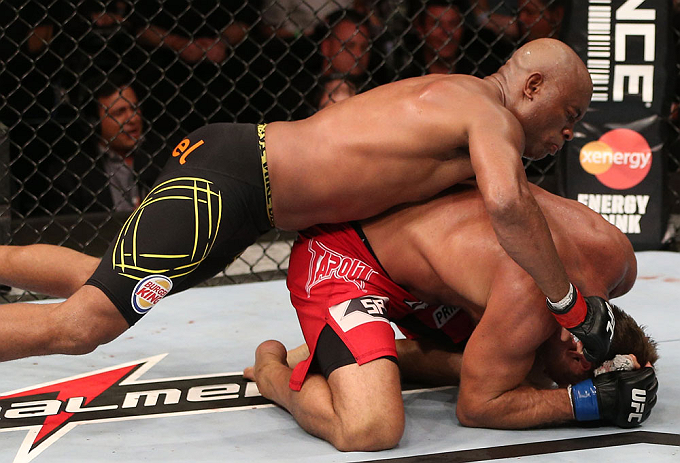 RIO DE JANEIRO, BRAZIL - OCTOBER 13:  (L-R) Anderson Silva punches Stephan Bonnar during their light heavyweight fight at UFC 153 inside HSBC Arena on October 13, 2012 in Rio de Janeiro, Brazil.  (Photo by Josh Hedges/Zuffa LLC/Zuffa LLC via Getty Images)