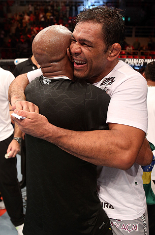 "RIO DE JANEIRO, BRAZIL - OCTOBER 13:  (L-R) Anderson Silva and his teammate Antonio Rodrigo ""Minotauro"" Nogeuira celebrate after Silva's victory over Stephan Bonnar during their light heavyweight fight at UFC 153 inside HSBC Arena on October 13, 2012 in Rio de Janeiro, Brazil.  (Photo by Josh Hedges/Zuffa LLC/Zuffa LLC via Getty Images)"