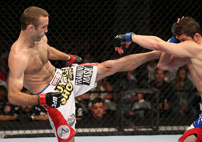 MINNEAPOLIS, MN - OCTOBER 05:  (L-R) Jacob Volkmann kicks Shane Roller during their lightweight fight at the UFC on FX event at Target Center on October 5, 2012 in Minneapolis, Minnesota.  (Photo by Josh Hedges/Zuffa LLC/Zuffa LLC via Getty Images)