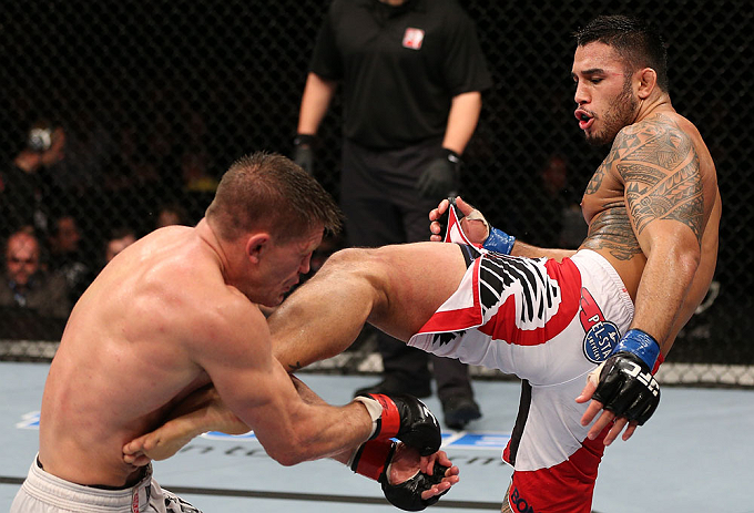 NOTTINGHAM, ENGLAND - SEPTEMBER 29:  (R-L) Brad Tavares kicks Tom Watson during their middleweight fight at the UFC on Fuel TV event at Capital FM Arena on September 29, 2012 in Nottingham, England.  (Photo by Josh Hedges/Zuffa LLC/Zuffa LLC via Getty Images)