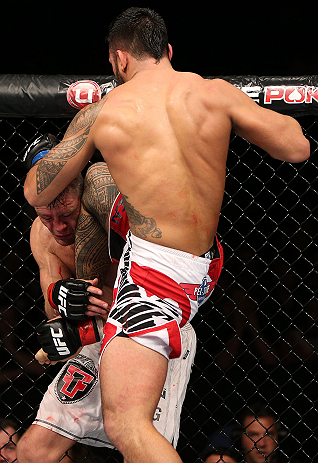 NOTTINGHAM, ENGLAND - SEPTEMBER 29:  (R-L) Brad Tavares delivers a flying knee against Tom Watson during their middleweight fight at the UFC on Fuel TV event at Capital FM Arena on September 29, 2012 in Nottingham, England.  (Photo by Josh Hedges/Zuffa LLC/Zuffa LLC via Getty Images)