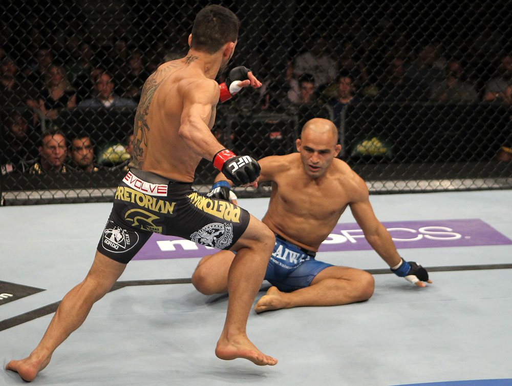 FAIRFAX, VA - MAY 15:  (L-R) Rafael Dos Anjos rushes in to finish Kamal Shalorus after knocking him down with a kick in a lightweight bout during the UFC on Fuel TV event at Patriot Center on May 15, 2012 in Fairfax, Virginia.  (Photo by Josh Hedges/Zuffa LLC/Zuffa LLC via Getty Images)