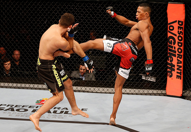 SAO PAULO, BRAZIL - JANUARY 19:  (R-L) Yuri Alcantara kicks Pedro Nobre in their bantamweight fight at the UFC on FX event on January 19, 2013 at Ibirapuera Gymnasium in Sao Paulo, Brazil. (Photo by Josh Hedges/Zuffa LLC/Zuffa LLC via Getty Images)