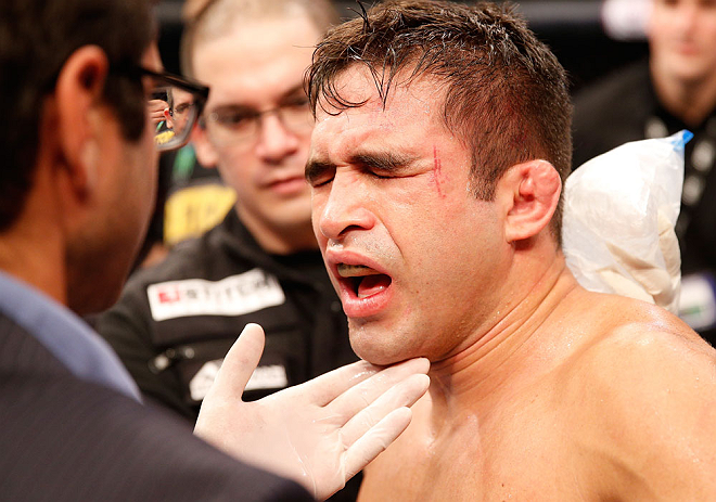 SAO PAULO, BRAZIL - JANUARY 19:  Pedro Nobre is treated by doctors after an illegal strike from Yuri Alcantara in their bantamweight fight at the UFC on FX event on January 19, 2013 at Ibirapuera Gymnasium in Sao Paulo, Brazil. (Photo by Josh Hedges/Zuffa LLC/Zuffa LLC via Getty Images)