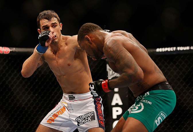 LAS VEGAS, NV - DECEMBER 29:  (L-R) Myles Jury punches Michael Johnson during their lightweight fight at UFC 155 on December 29, 2012 at MGM Grand Garden Arena in Las Vegas, Nevada. (Photo by Josh Hedges/Zuffa LLC/Zuffa LLC via Getty Images) *** Local Caption *** Michael Johnson; Myles Jury