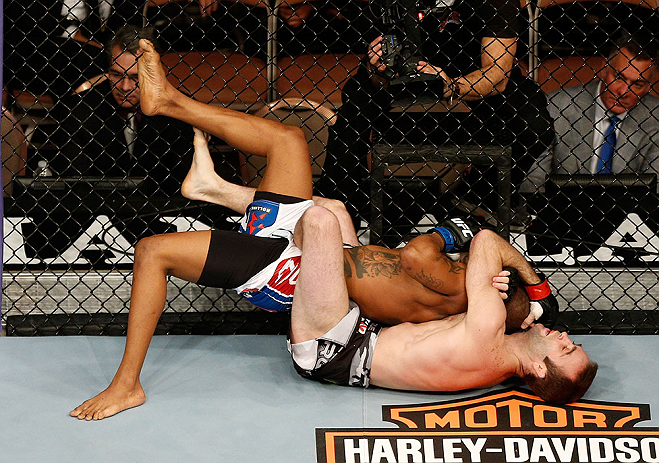 LAS VEGAS, NV - FEBRUARY 02:  Jacob Volkmann (bottom) attempts to submit Bobby Green during their lightweight fight at UFC 156 on February 2, 2013 at the Mandalay Bay Events Center in Las Vegas, Nevada.  (Photo by Josh Hedges/Zuffa LLC/Zuffa LLC via Getty Images) *** Local Caption *** Jacob Volkmann; Bobby Green