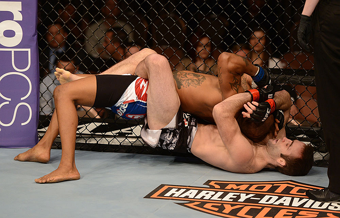 LAS VEGAS, NV - FEBRUARY 02:  Jacob Volkmann (bottom) attempts to submit Bobby Green during their lightweight fight at UFC 156 on February 2, 2013 at the Mandalay Bay Events Center in Las Vegas, Nevada.  (Photo by Donald Miralle/Zuffa LLC/Zuffa LLC via Getty Images) *** Local Caption *** Jacob Volkmann; Bobby Green