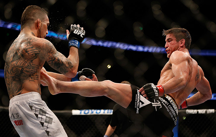 ANAHEIM, CA - FEBRUARY 23:  (R-L) Sam Stout kicks Caros Fodor in their lightweight bout during UFC 157 at Honda Center on February 23, 2013 in Anaheim, California.  (Photo by Josh Hedges/Zuffa LLC/Zuffa LLC via Getty Images) *** Local Caption *** Sam Stout; Caros Fodor