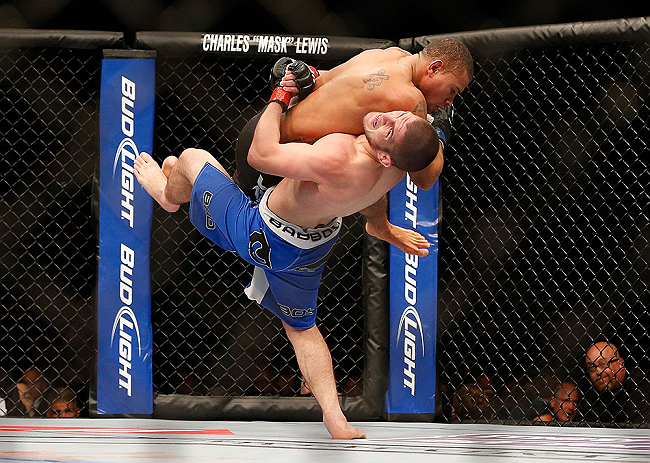 LAS VEGAS, NV - MAY 25:   Khabib Nurmagomedov (blue shorts) slams Abel Trujillo in their lightweight bout during UFC 160 at the MGM Grand Garden Arena on May 25, 2013 in Las Vegas, Nevada.  (Photo by Josh Hedges/Zuffa LLC/Zuffa LLC via Getty Images)  *** Local Caption *** Khabib Nurmagomedov; Abel Trujillo