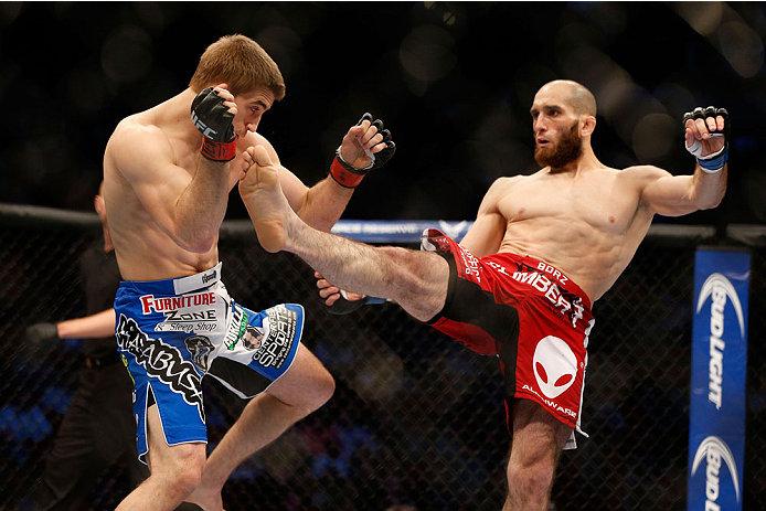 HOUSTON, TEXAS - OCTOBER 19:  (R-L) Adlan Amagov lands a kick to the body of TJ Waldburger in their UFC welterweight bout at the Toyota Center on October 19, 2013 in Houston, Texas. (Photo by Josh Hedges/Zuffa LLC/Zuffa LLC via Getty Images)