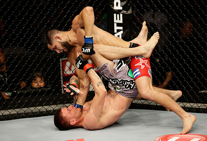 SAN JOSE, CA - APRIL 20:   Jorge Masvidal (top) punches Tim Means in their lightweight bout during the UFC on FOX event at the HP Pavilion on April 20, 2013 in San Jose, California.  (Photo by Ezra Shaw/Zuffa LLC/Zuffa LLC via Getty Images)  *** Local Caption *** Tim Means; Jorge Masvidal