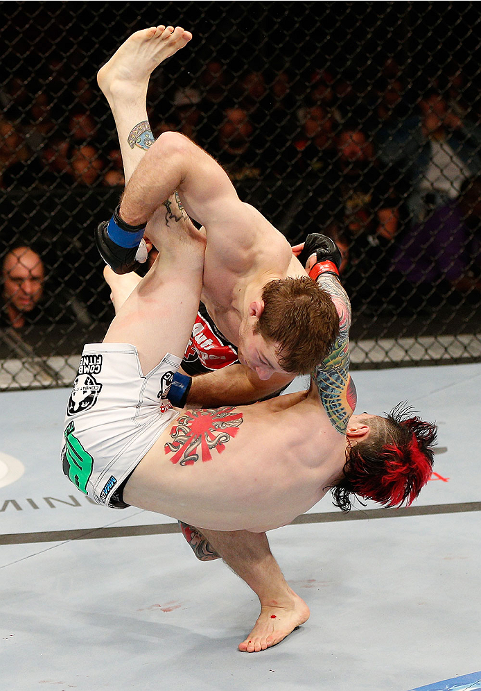 SACRAMENTO, CA - DECEMBER 14:  Zach Makovsky (top) slams Scott Jorgensen in their flyweight bout during the UFC on FOX event at Sleep Train Arena on December 14, 2013 in Sacramento, California. (Photo by Josh Hedges/Zuffa LLC/Zuffa LLC via Getty Images) *** Local Caption *** Scott Jorgensen; Zach Makovsky