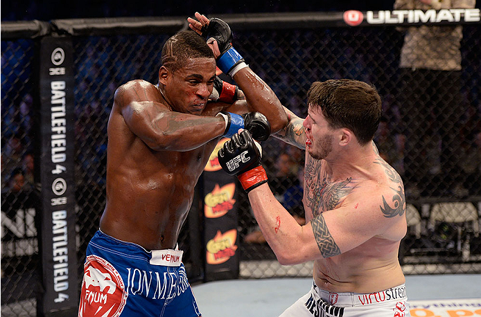 FORT CAMPBELL, KENTUCKY - NOVEMBER 6:  (R-L) Chris Camozzi punches Lorenz Larkin in their UFC middleweight bout on November 6, 2013 in Fort Campbell, Kentucky. (Photo by Jeff Bottari/Zuffa LLC/Zuffa LLC via Getty Images) *** Local Caption ***Chris Camozzi; Lorenz Larkin