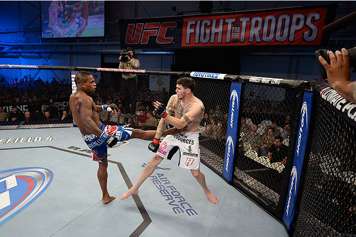 FORT CAMPBELL, KENTUCKY - NOVEMBER 6:  (L-R) Lorenz Larkin kicks Chris Camozzi in their UFC middleweight bout on November 6, 2013 in Fort Campbell, Kentucky. (Photo by Jeff Bottari/Zuffa LLC/Zuffa LLC via Getty Images) *** Local Caption ***Chris Camozzi; Lorenz Larkin