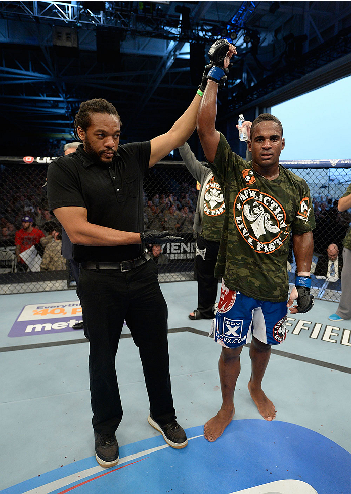 FORT CAMPBELL, KENTUCKY - NOVEMBER 6:  Lorenz Larkin (right) is declared the winner over Chris Camozzi in their UFC middleweight bout on November 6, 2013 in Fort Campbell, Kentucky. (Photo by Jeff Bottari/Zuffa LLC/Zuffa LLC via Getty Images) *** Local Caption ***Lorenz Larkin
