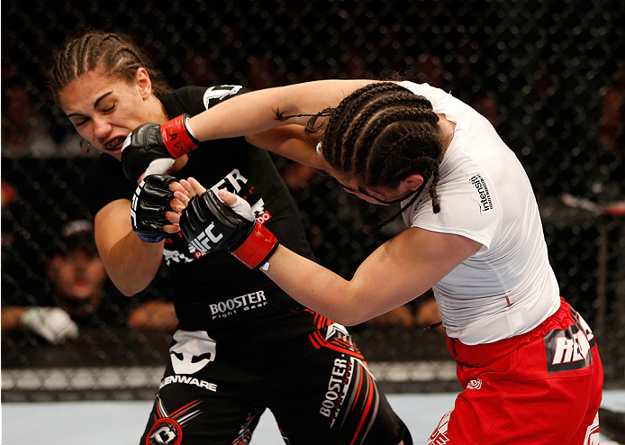 MANCHESTER, ENGLAND - OCTOBER 26:  (R-L) Rosi Sexton punches Jessica Andrade in their women's bantamweight bout during the UFC Fight Night event at Phones 4 U Arena on October 26, 2013 in Manchester, England. (Photo by Josh Hedges/Zuffa LLC/Zuffa LLC via Getty Images)