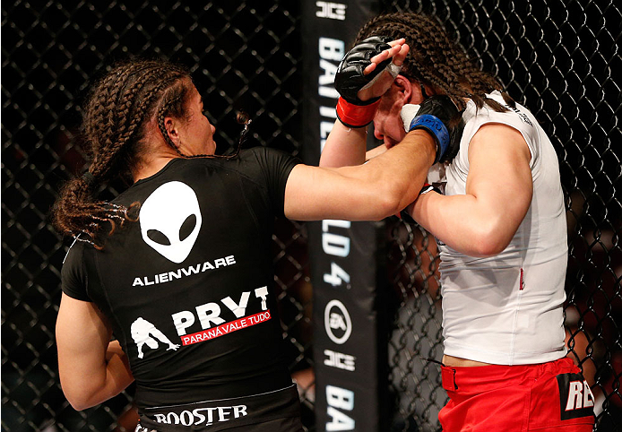 MANCHESTER, ENGLAND - OCTOBER 26:  (L-R) Jessica Andrade punches Rosi Sexton in their women's bantamweight bout during the UFC Fight Night event at Phones 4 U Arena on October 26, 2013 in Manchester, England. (Photo by Josh Hedges/Zuffa LLC/Zuffa LLC via Getty Images)