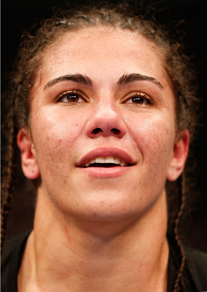 MANCHESTER, ENGLAND - OCTOBER 26: Jessica Andrade reacts after her decision victory over Rosi Sexton in their women's bantamweight bout during the UFC Fight Night event at Phones 4 U Arena on October 26, 2013 in Manchester, England. (Photo by Josh Hedges/Zuffa LLC/Zuffa LLC via Getty Images)