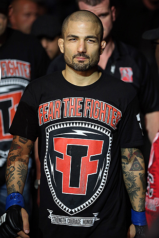 NOTTINGHAM, ENGLAND - SEPTEMBER 29:  Akira Corassani enters the arena before his featherweight fight against Andy Ogle at the UFC on Fuel TV event at Capital FM Arena on September 29, 2012 in Nottingham, England.  (Photo by Josh Hedges/Zuffa LLC/Zuffa LLC via Getty Images)