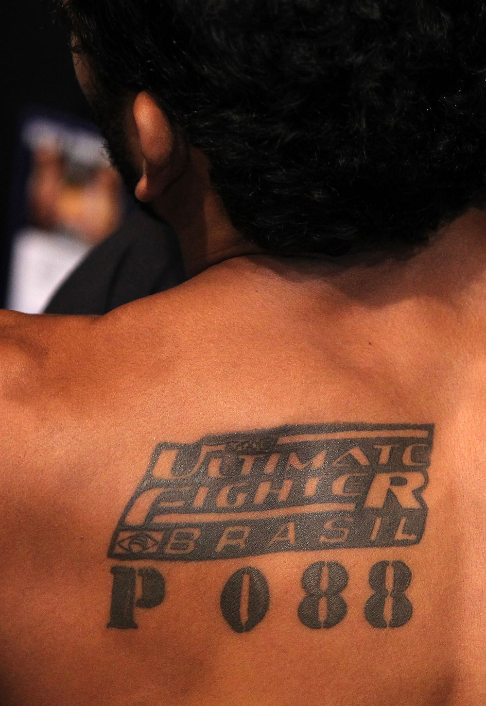 "BELO HORIZONTE, BRAZIL - JUNE 23:   A tattoo is seen on the back of Hugo ""Wolverine"" Viana before his UFC 147 featherweight bout against John Teixeira at Estadio Jornalista Felipe Drummond on June 23, 2012 in Belo Horizonte, Brazil.  (Photo by Josh Hedges/Zuffa LLC/Zuffa LLC via Getty Images)"