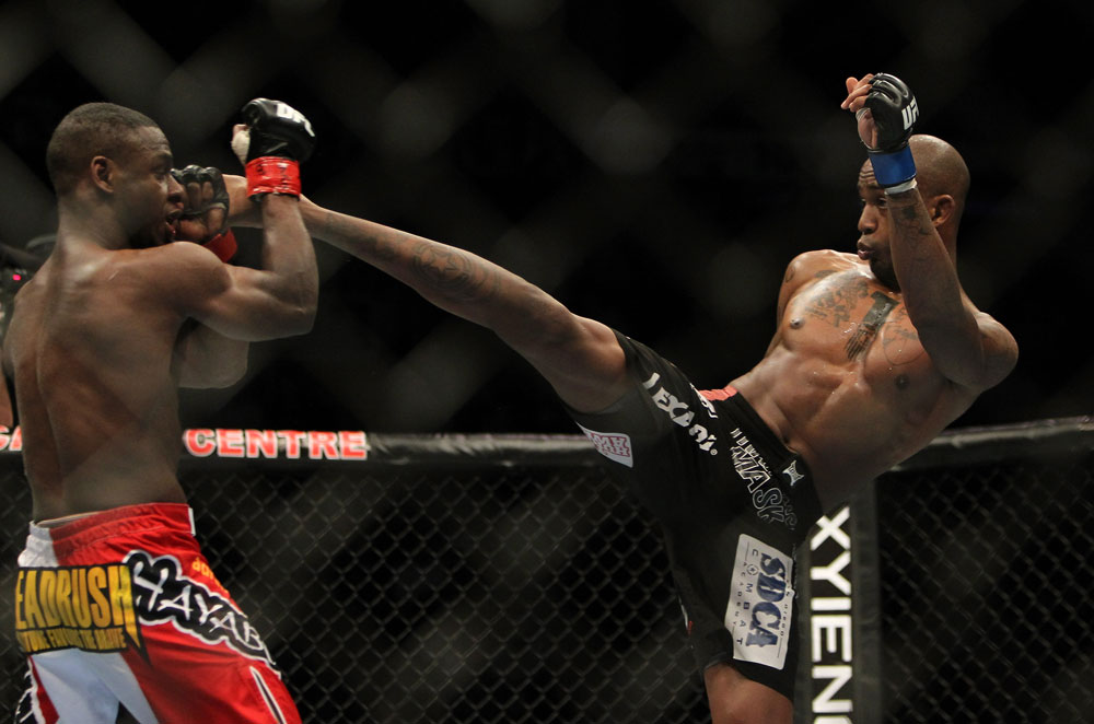 TORONTO, ON - DECEMBER 10:  (R-L) Walel Watson kicks Yves Jabouin during the UFC 140 event at Air Canada Centre on December 10, 2011 in Toronto, Ontario, Canada.  (Photo by Josh Hedges/Zuffa LLC/Zuffa LLC via Getty Images)