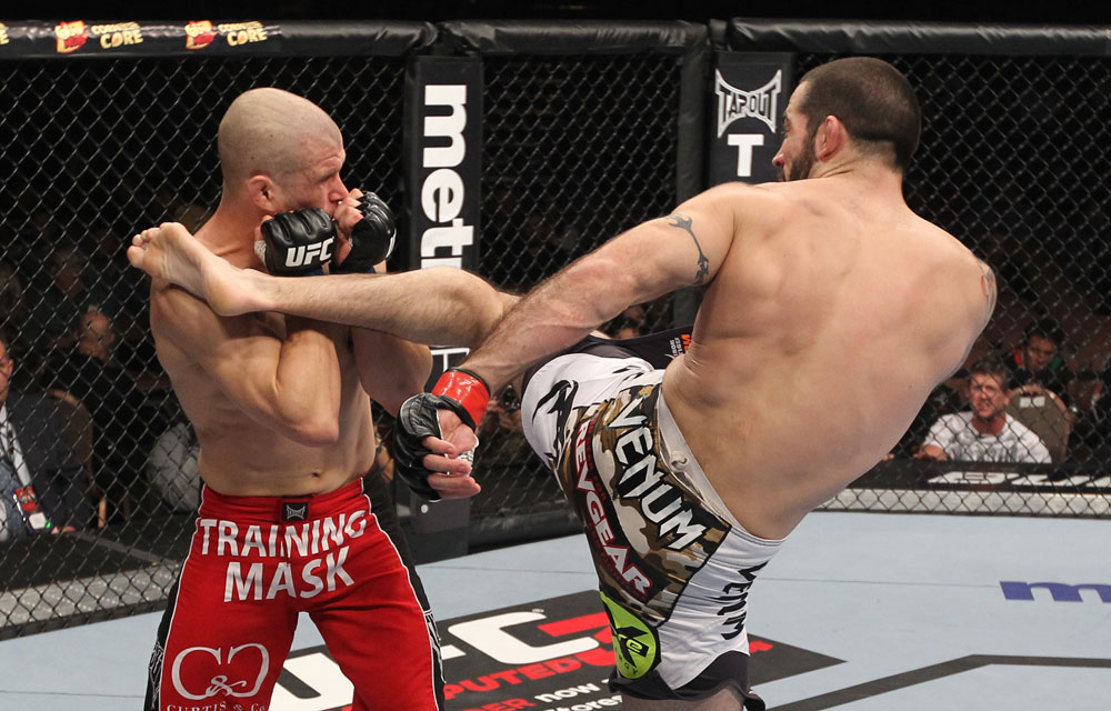LAS VEGAS, NV - FEBRUARY 04:  Matt Brown (right) kicks Chris Cope during the UFC 143 event at Mandalay Bay Events Center on February 4, 2012 in Las Vegas, Nevada.  (Photo by Nick Laham/Zuffa LLC/Zuffa LLC via Getty Images) *** Local Caption *** Matt Brown; Chris Cope