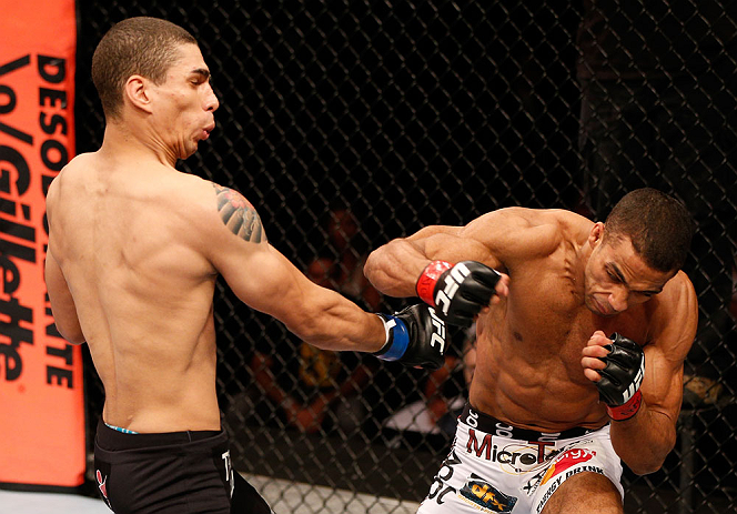 SAO PAULO, BRAZIL - JANUARY 19:  (R-L) Edson Barboza punches Lucas Martins in their lightweight fight at the UFC on FX event on January 19, 2013 at Ibirapuera Gymnasium in Sao Paulo, Brazil. (Photo by Josh Hedges/Zuffa LLC/Zuffa LLC via Getty Images)
